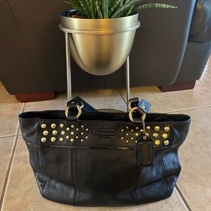 COACH black purse with gold accents, medium